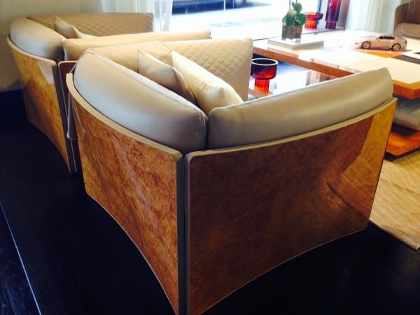 Bentley Club Chairs in signature quilted Bentley leather and sheathed in the automakers famed Burled wood