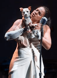 Audra McDonald, as the drug-and-alcohol-addicted Billie Holiday, bringing her dog onstage in an attempt to cheer herself up_