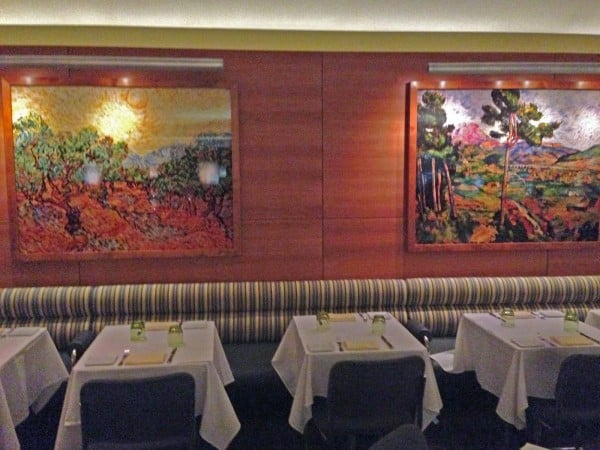 A pair of works by artist Vik Munoz center the restaurant