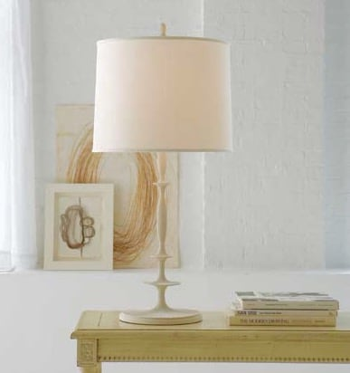 white lamp on light wood table with three books
