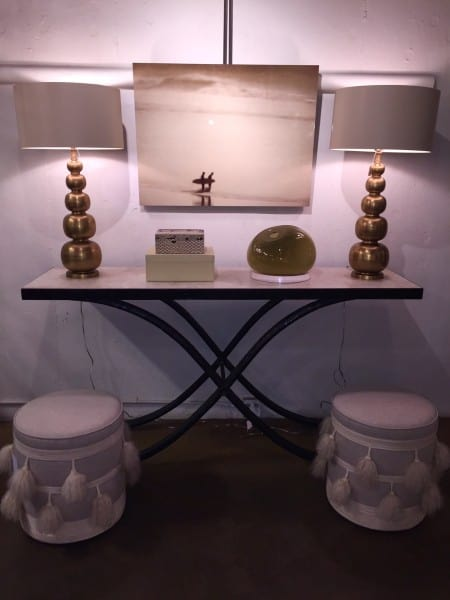 pair of lamps and a pair of ottomans