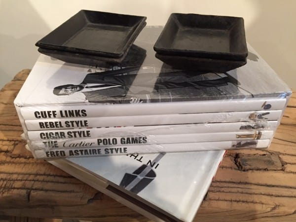 set of books featuring black and white dust jackets