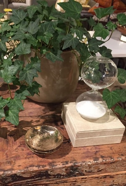 end table with potted plant and hourglass