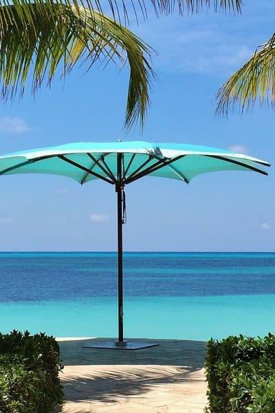 Aqua blue and white Crescent umbrella on the beach