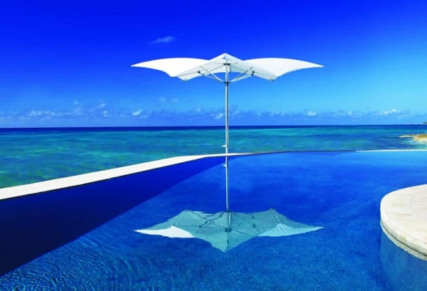The Manta umbrella straddles the beach and pool